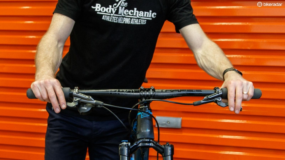Bars rolled backwards to be flatter across the top. Note how the elbows are in a more neutral position, thereby easing tension on your shoulders and neck.